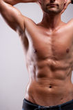 Young man trained topless with abs Royalty Free Stock Photo