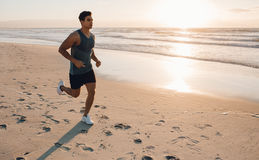 Young man training on the beach in morning Royalty Free Stock Photography