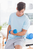 Young man training with dumbbells Stock Photos