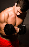 Young man training with dumbell Royalty Free Stock Photos