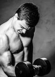 Young man training with dumbell Royalty Free Stock Photography