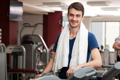 Young man training in the gym Stock Photography