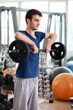 Young man training in the gym Royalty Free Stock Images