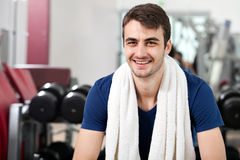 Young man training in the gym Royalty Free Stock Image