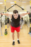 Young man training in gym Royalty Free Stock Photography