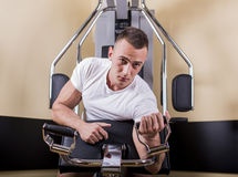 Young man training in the gym Royalty Free Stock Photo