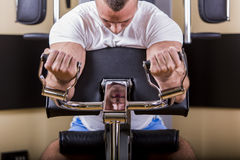 Young man training in the gym Stock Photo