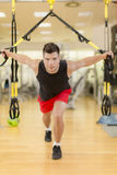Young man training in the gym Stock Images