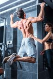 Young man training in the Gym Stock Photos