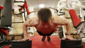Young man is training in the gym. Young strong man is training in the gym stock footage