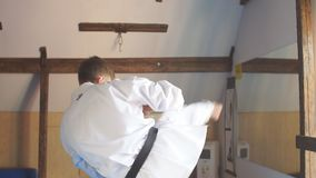 Man training karate in gym. Young man training karate, sport and fitness at gym. Slow motion stock footage