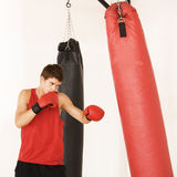A young man training on a punch bag Royalty Free Stock Images
