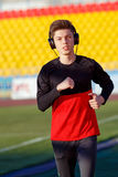 Young man is training at a sports stadium Stock Image