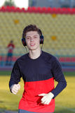 Young man is training at a sports stadium Royalty Free Stock Image