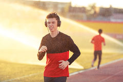 Young man is training at a sports stadium Royalty Free Stock Images