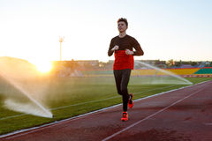 Young man is training at a sports stadium Stock Photo