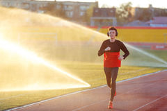 Young man is training at a sports stadium Royalty Free Stock Photography