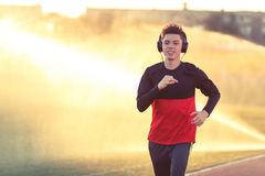 Young man is training at a sports stadium Stock Photography