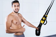 Young man training with TRX Stock Photo
