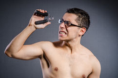 Young man trains on white royalty free stock photography