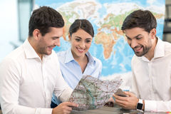 Young Man Travel Agent with Clients Concept Royalty Free Stock Images