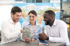 Young Man Travel Agent with Clients Concept Stock Image