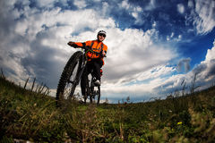 Young man travel by bicycle on rural road Stock Images