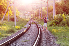 Young Man in Travel Clothing hitch hiking Railroad Train Stock Images