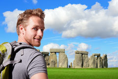 Young man travel in stonehenge. An ancient prehistoric stone monument near Salisbury, Wiltshire, UK. in England. caucasian Stock Photo