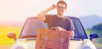 Young man with travel suitcase Stock Photos