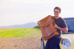 Young man with travel suitcase Royalty Free Stock Photography