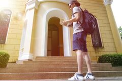 young man traveler with a backpack on his shoulder out sightseei Royalty Free Stock Photography