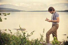 Young Man Traveler with backpack reading book stock image