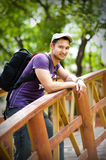 Young man traveler with  black backpack Stock Photos