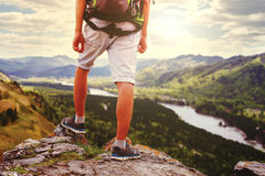 Young Man Traveler feet standing alone with  mountains on backgr Stock Photos