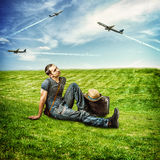 Young man traveler and flying airplanes Stock Photo