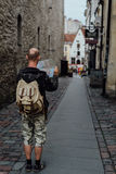 Young man traveler looking city map in old town. Young man traveler looking city map on street Royalty Free Stock Photo