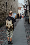 Young man traveler looking city map in old town. Young man traveler looking city map on street Stock Photos