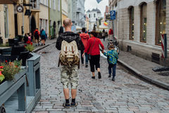 Young man traveler looking city map in old town. Young man traveler looking city map on street Stock Photo