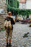 Young man traveler looking city map in old town. Young man traveler looking city map on street Royalty Free Stock Photos