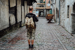 Young man traveler looking city map in old town. Young man traveler looking city map on street Royalty Free Stock Image
