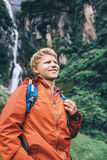 Young man traveler portrait in rainy forest Royalty Free Stock Image