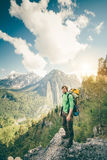 Young Man Traveler relaxing outdoor with mountains on background Stock Images