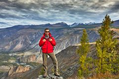 Young Man Traveler relaxing outdoor with rocky mountains on background Autumn vacations and Lifestyle stock photos