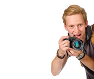 Young man traveler taking pictures by dslr camera isolated Stock Photography