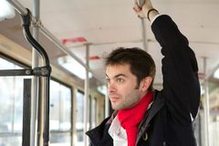 Young man traveling alone by public transport Stock Photos