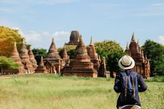 Young man traveling backpacker with hat, Asian traveler looking Beautiful ancient temples and pagoda, landmark and popular for. Tourist attractions in Bagan stock photos