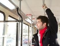 Young man traveling by public transport Royalty Free Stock Photos