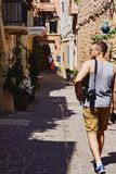 Young man traveller with camera and cell phone exploring the foreign city Chania, Creta, Greece. Young man traveller with camera and cell phone exploring the Royalty Free Stock Photos