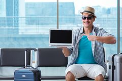 The young man travelling for his summer beach vacation. Young man travelling for his summer beach vacation Stock Photography